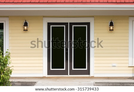 Door entrance and two lights - stock photo