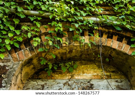 Door frame of the old ruined building - stock photo