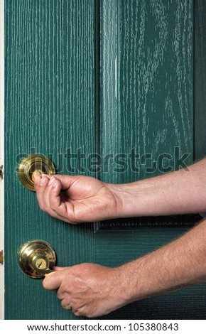 Door handle and deadbolt locked is safe - stock photo