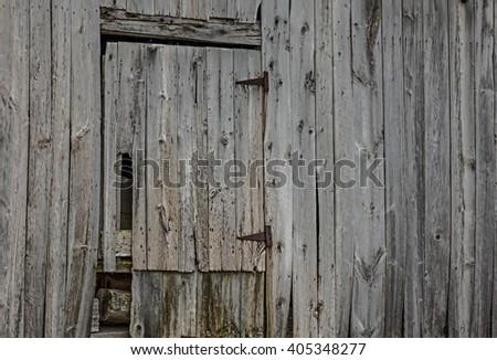 Door in derelict wooden barn - stock photo