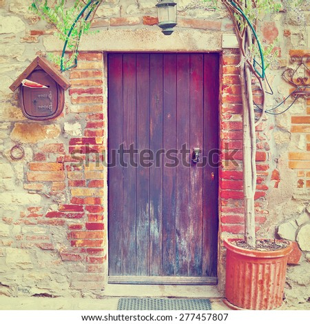Door in Italian House Decorated with Tree, Instagram Effect - stock photo