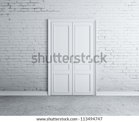 door in the brick white  wall - stock photo