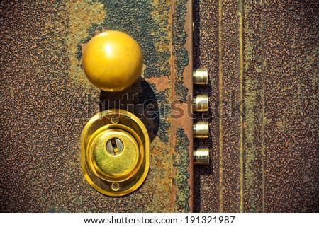 Door lock close up. Photo tinted yellow - stock photo