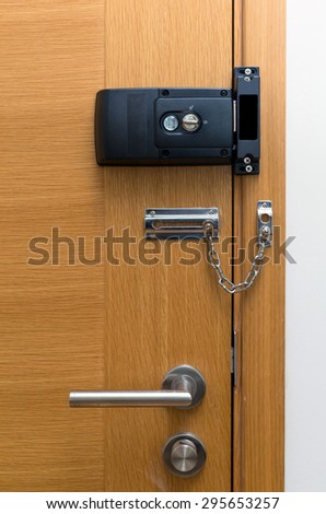 Door lock on wooden door - stock photo