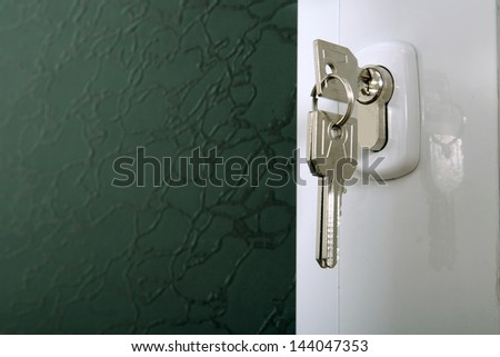 Door lock with keys macro shot. Real estate concept - stock photo