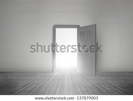 Door opening to reveal bright light in a dull grey room - stock photo