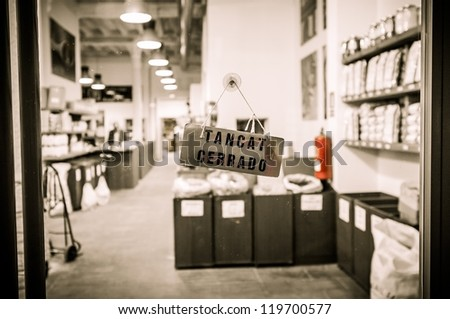 "Door sign says ""Closed"" on shop entrance - stock photo"