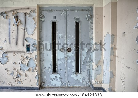 Door to the elevator in an abandoned building - stock photo