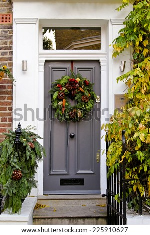 Door with natural wreath decoration for Christmas holiday   - stock photo