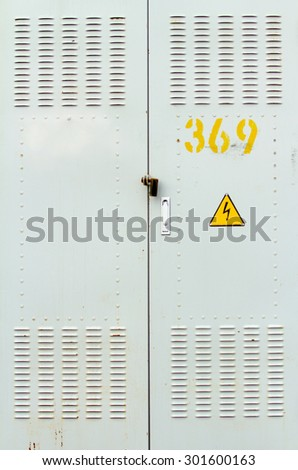 door with the sign of lightning electricity - stock photo
