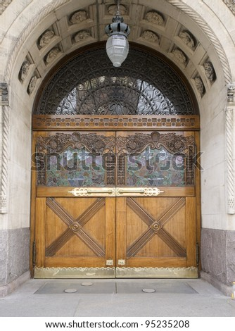Door with wood carwing, leaded glass and wrought-iron lattice. From the center of Aarhus, Denmark - stock photo