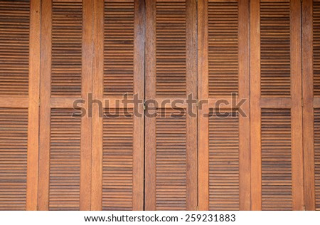 door woods hinge locked by key for backgrounds - stock photo