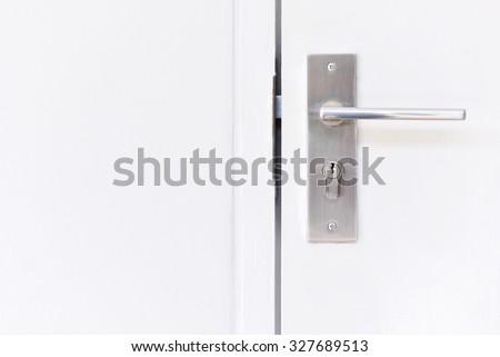 Doorknob at a white door - stock photo