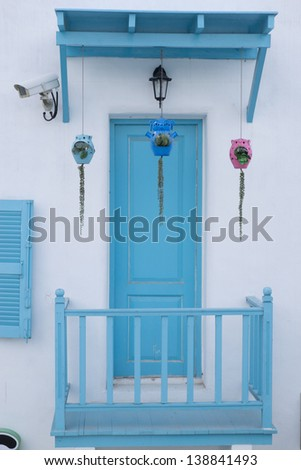 Doors and walls white blue awning. - stock photo