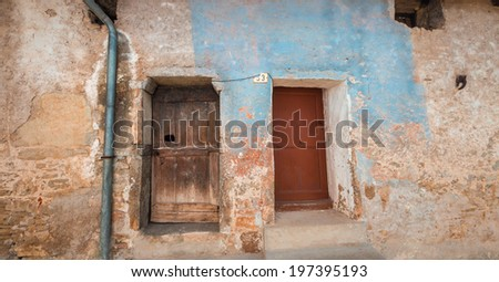 Doors and windows of an ancient house in a little village of italy - stock photo