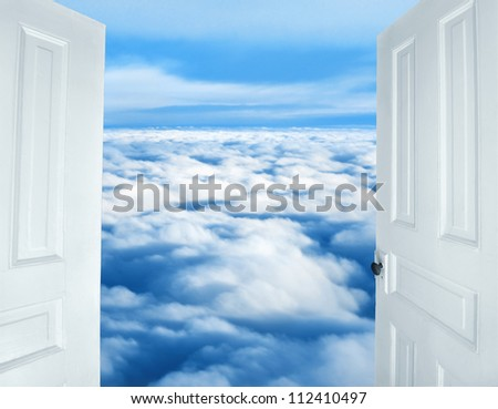 Doors opening to a heavenly sight of fluffy clouds - stock photo
