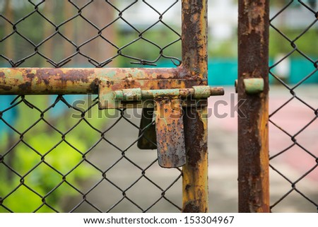 doors rusted iron fence on the tennis court - stock photo