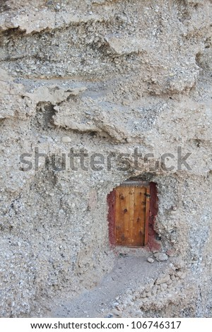 Doorway into a mountain � Buddhist hermit meditation cave in Tibet - stock photo