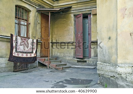 Doorway to old apartment building in city outskirts - stock photo