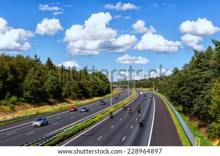 DOORWERTH, NETHERLANDS- JULY 7, 2012: View of the roads in Doorwerth Netherlands.  With 139,295 km of public roads, the Netherlands has one of the most dense road networks in the world. - stock photo