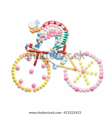 Doping drugs and pills in the shape of a road bicycle racer on a bike. - stock photo