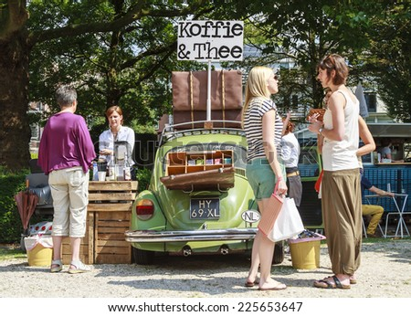 DORDRECHT, NETHERLANDS - AUGUSTUS 10, 2014: Selling coffee and tea out of a car at the summer Swan Market in Dordrecht. The lifestyle market was originally started in vacant shops in Rotterdam - stock photo