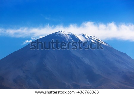dormant volcano on the background of the sky - stock photo