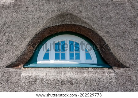 Dormer of a traditional thatched-roof house, baltic sea, germany - stock photo