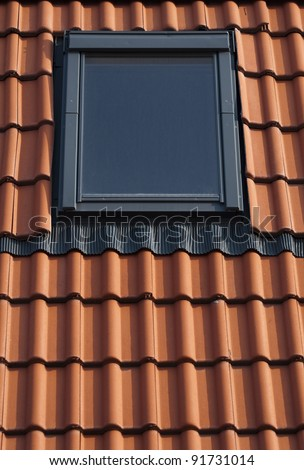 Dormer on a red tiled roof - stock photo