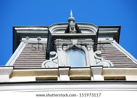 Dormer There are a dormer and a blue sky.  - stock photo