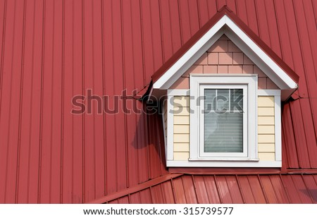 Dormer window on red roof - stock photo