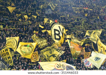 Dortmund, Germany- December 10, 2015: Dortmund fans celebrating for their team during the match UEFA Europa League match between PAOK vs Borussia Dortmund played at BVB Stadium - stock photo