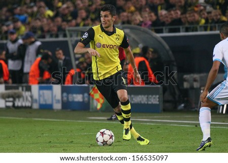 DORTMUND, GERMANY - OCT 1: Nuri Sahin (BVB) during a Champions League match between Borussia Dortmund & Olympique de Marseille, final score 3-0, on October 1, 2013, in Dortmund, Germany. - stock photo