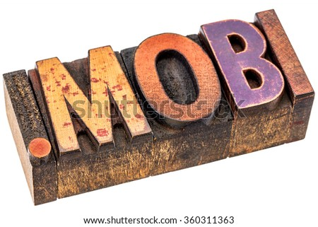 dot mobi - top level internet domain by mobile devices, isolated text in grunge letterpress wood type - stock photo