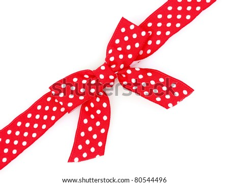 Dotted red ribbon and bow isolated on white background - stock photo
