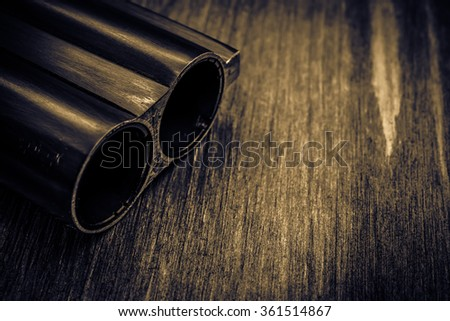 Double-barreled shotgun barrel. Close up view, image vignetting and the yellow toning - stock photo