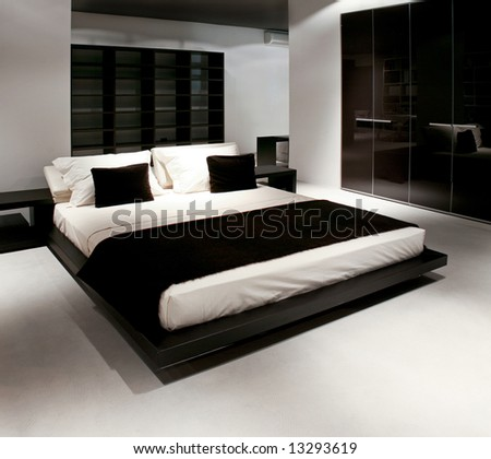 Double bed and wardrobe in big bedroom - stock photo