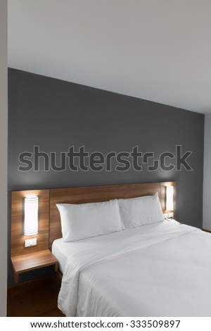 Double bed with wood headboard. - stock photo
