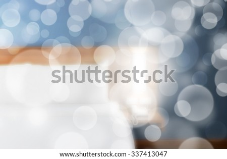 Double bed with wood headboard and soft bokeh. - stock photo