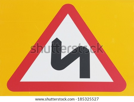 Double Bend Sign Against A Yellow Background.  - stock photo
