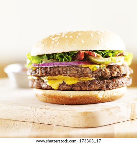 double cheese burger with bacon wide shot - stock photo