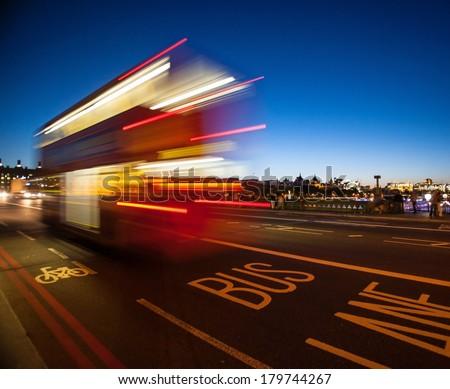Double-Decker bus crossing Westminster Bridge at night in London, England./Double-Decker bus crossing Westminster Bridge at night/Double-Decker bus crossing Westminster Bridge at night - stock photo