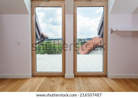 Double door to a terrace with beautiful view - stock photo