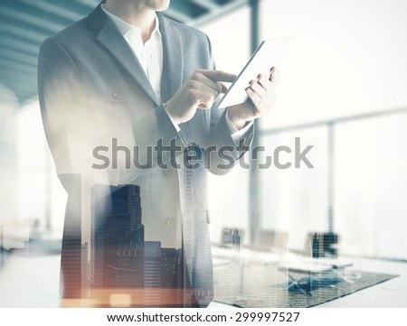 Double exp business man with tablet  - stock photo