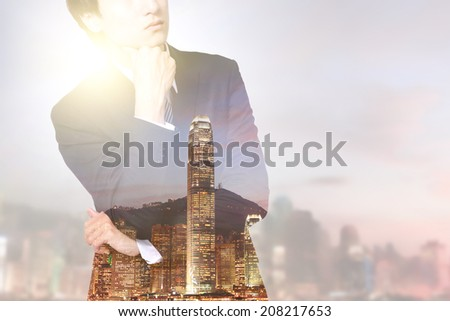 double exposure business man and city - business man think with city night skyline, asia, china, hong kong - stock photo