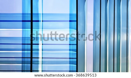 Double exposure close-up photo of parallel metal frames of French windows and patio doors. Material design on the subject of modern glass architecture. Hi-tech background for a list. - stock photo