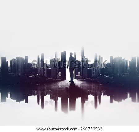 Double exposure concept with businessman and city - stock photo