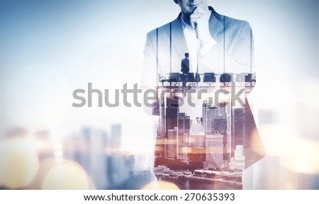 Double exposure concept with thinking businessman and city. With special lighting effects - stock photo