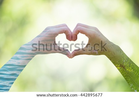 Double exposure for the human Heart shaped green leaves blurry. And pure water blurry.On blurred background bokeh green from natural light. Environment Day concept. Ecology concept. - stock photo