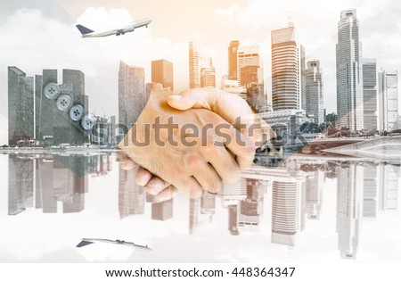 Double exposure handshake of business peoples with the airplane flying over the city background.   - stock photo
